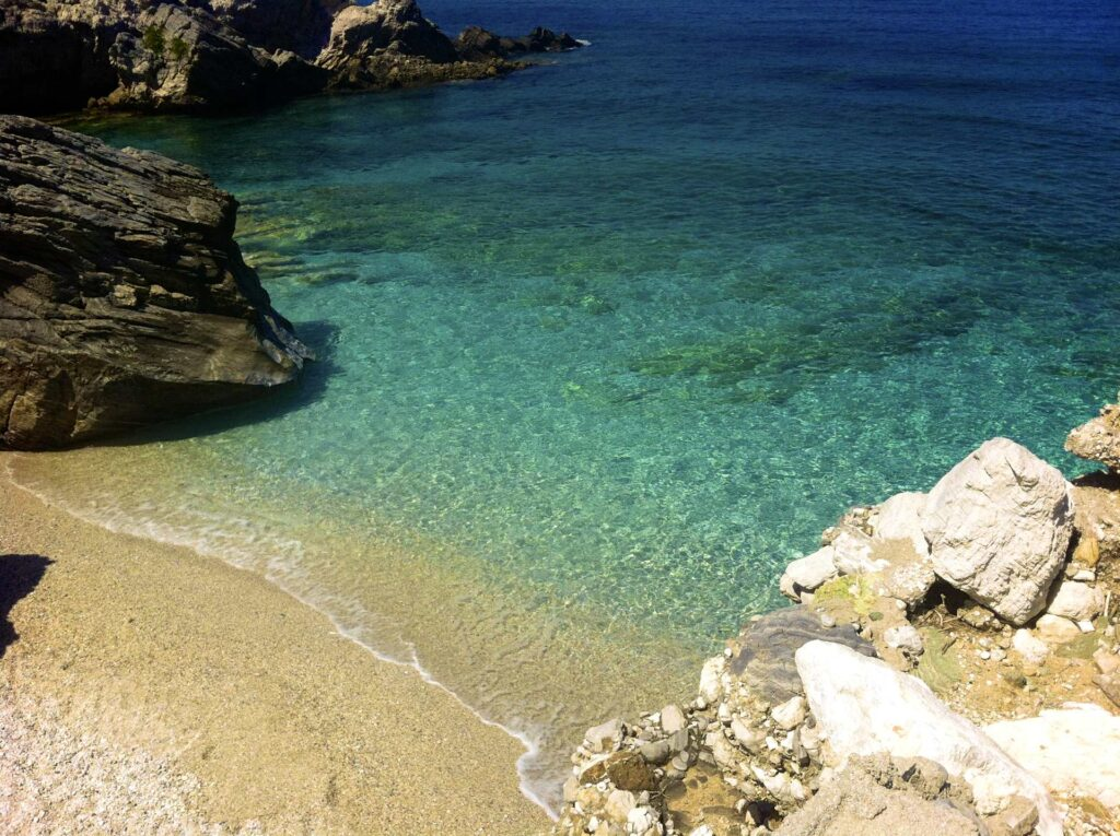 An amazing tropical-like beach in Pelion with blue-green water and golden sand.